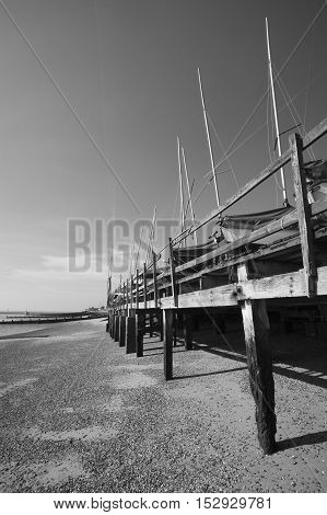 Black and white image of boats in winter storage on Southend Beach Essex England