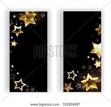 Two banners with small shiny gold stars on a black background. Design with gold stars.