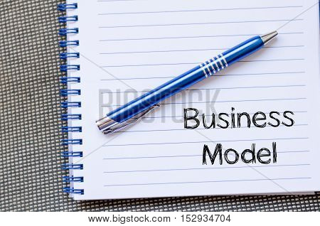 Business model text concept write on notebook