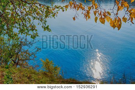 Warm autumn landscape of the lake in the sun