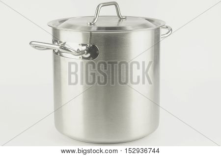 A large metal pot closed the lid standing on white background
