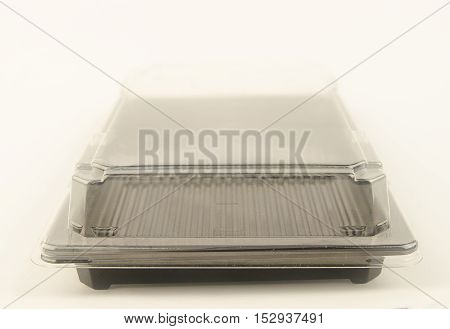 Plastic containers for food. The transparent lid and black bottom. Horizontal photo. From the side