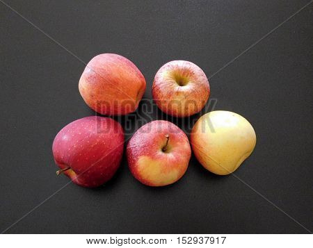 apples to eat on a black background