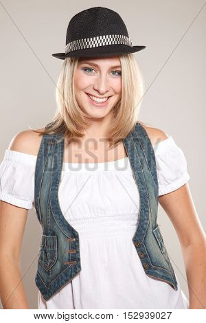 Young blond woman dressed in black hat and casual jeans clothes with