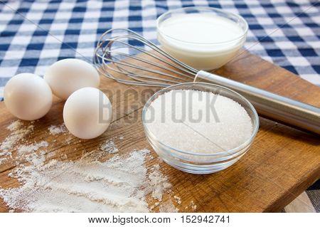 Background food. Preparation of the test. Baking ingredients,eggs,flour,milk,sugar