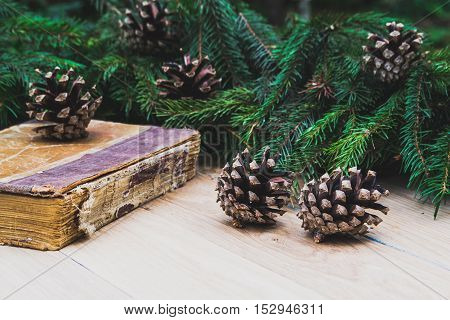 Christmas decoration and old books on a wooden table