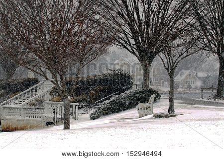 Snow is falling at Argyle Lake in Babylon Village New York.