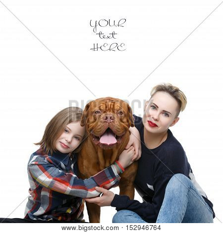 Mother and daughter in casual clothes hugging big brown dogue de bordeaux dog. People with pet. Isolated on white.