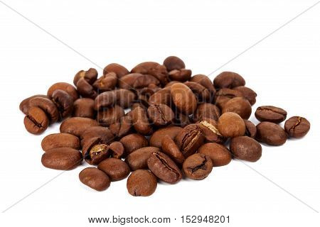 Pile of roasted coffee beans isolated in white background