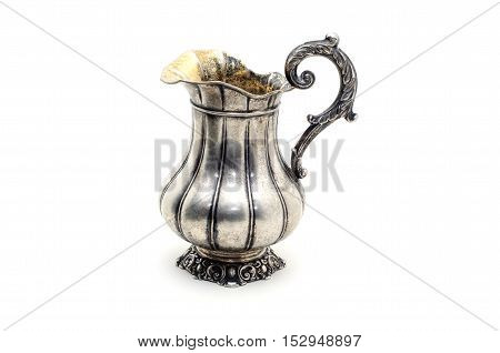 Antique silver jug isolated on a white background.