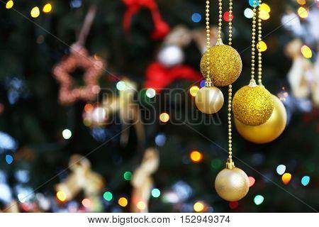 Beautiful balls on blurred Christmas tree background, closeup