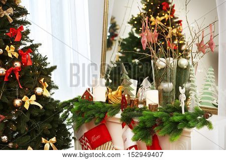 Fir tree and fireplace with Christmas decor, close up view