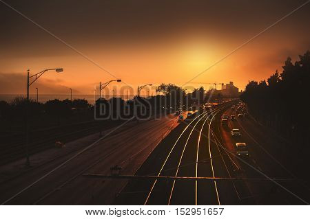 Beautiful landscape scene and sunrise above railway road from a bridge. Railroad with vintage toning