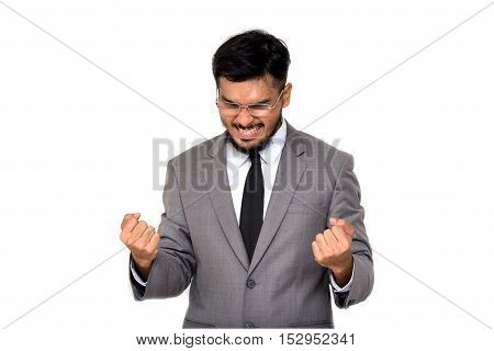 Portrait of sucessful Asian businessman celebrating with hands up isolated on white bacground.