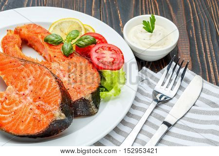 Crispy roasted salmon steak Isolated on wooden background