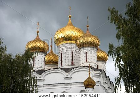 Domes of the old Cathedral of the Holy Trinity Ipatiev Monastery closeup gloomy September day. Kostroma Golden Ring of Russia