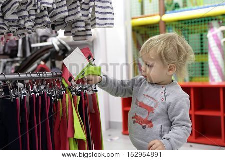 Child Choosing Clothes