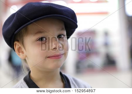 Portrait of a child in large cap
