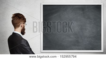 Concept Of Creativity And Lack Of Ideas. Young Bearded Businessman Wearing Glasses And Suit Standing