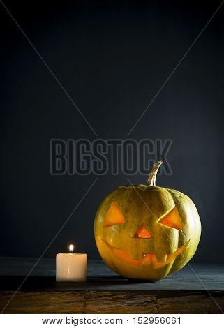 Halloween pumpkin with candles on a dark background