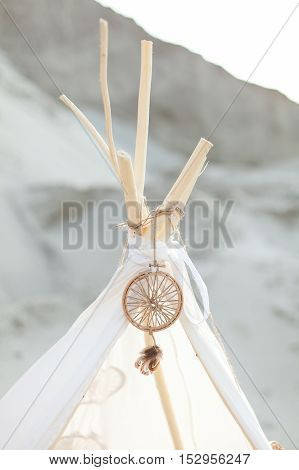 Indian tent. Dreamcatcher on white tent. Hunter of dreams. White tent.