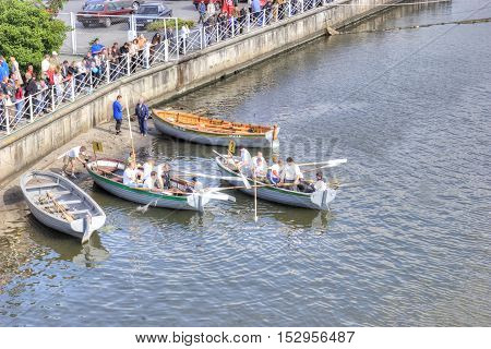 KALININGRAD RUSSIA - September 15.2008: Racing of rowers on oar boats in swimming to down the Pregolya River