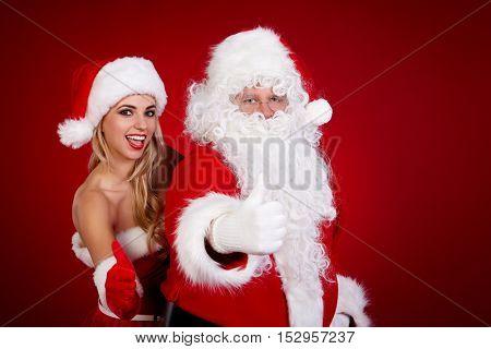 Santa claus and amazing christmas girl.