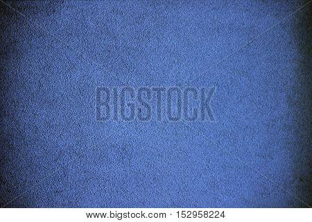 A grainy grungy background in dark blue.