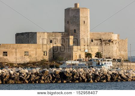 TRAPANI ITALY - AUGUST 10 2016: Castle of Colombaia located on a small island in front of the Trapani's harbor. This is one of the oldest monuments in the city tracing its origins to antiquity.