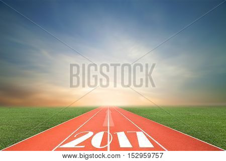 Running track with green grass and blue sky white cloud