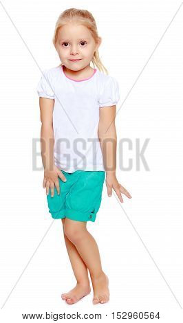 Cute little blond girl in white tank top without a pattern.Cute girl poses for the camera.Isolated on white background