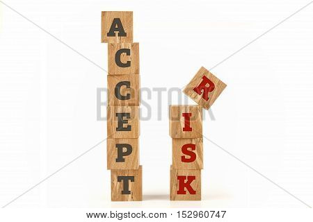 Accept Risk word written on cube shape wooden surface isolated on white background.
