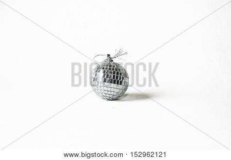 One Christmas tree ball made of mirror glass on a white background.