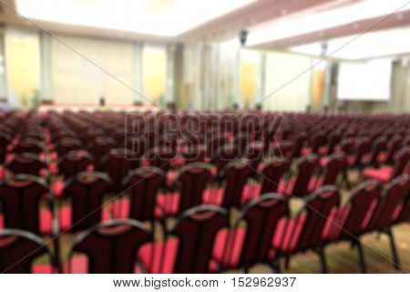 Abstract blurred photo of conference hall or seminar room nobody