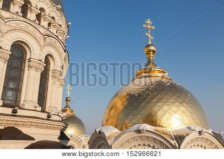 Cathedral dome close up. Dome of church. Gold dome of church. Gold dome and cross close up.