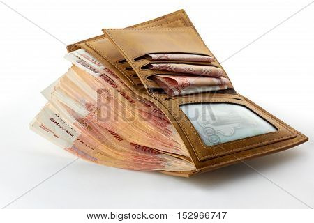 A lot of russian money roubles in wallet.
