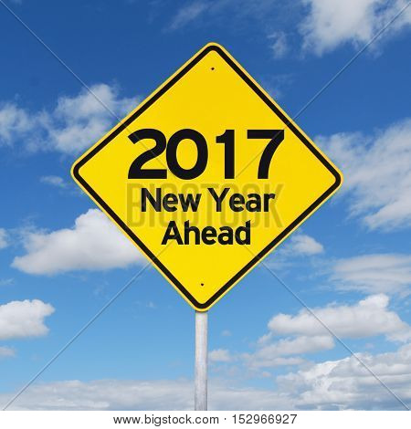 Image of a yellow road sign with text 2017 new year ahead shot under clear sky
