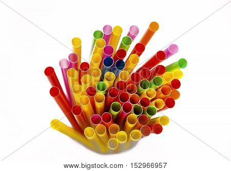 many colorful drinking straws top view. white background