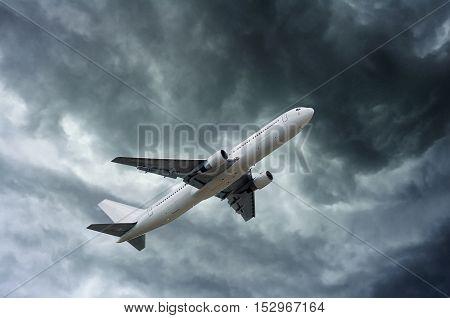 Airplane On Impressive Gray Cloud Before Rain