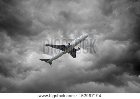 Airplane On Dark Stormy Sky