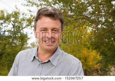 Handsome and middle age man outdoor smiling