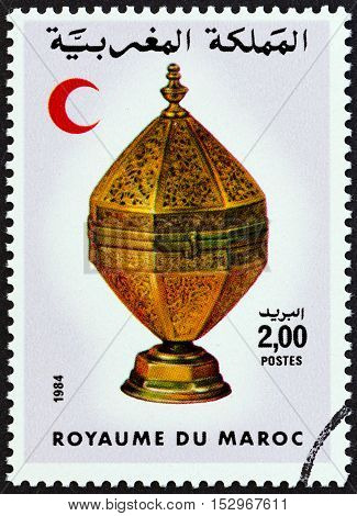 MOROCCO - CIRCA 1984: A stamp printed in Morocco shows Red Crescent and Octagonal brass container, circa 1984.