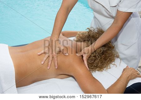 Woman Is Getting A Back Massage In Spa Center