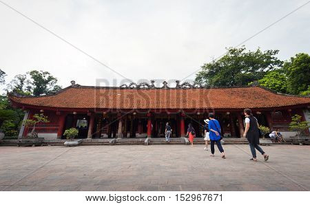 Hanoi Vietnam - September 20 2016: People walking into temple of literature or Van Mieu - Quoc Tu Giam the first university in Vietnam