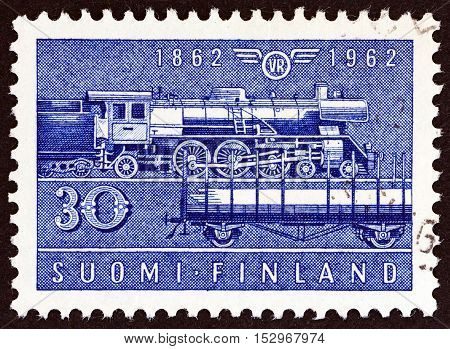 FINLAND - CIRCA 1962: A stamp printed in Finland issued for the 100th anniversary of the railway shows Class Hr-1 steam locomotive and Type Hk wagon, circa 1962.