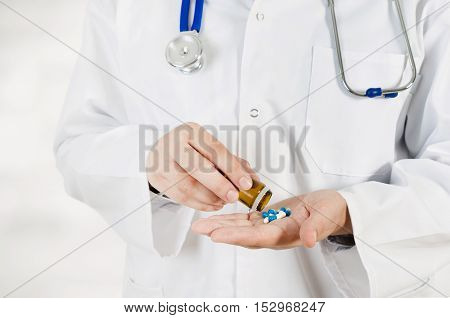 Doctor Pouring Pills On His Hand. Medical Concept In Hospital.
