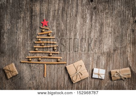 Xmas Tree And Gift Box On Rustic Wooden Background