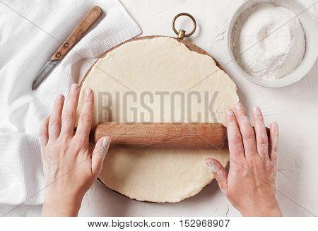Women's Hands Roll The Dough