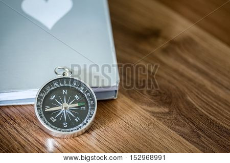 Simple Compass Over The Book On The Wooden Table With Copy Space