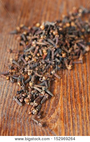 Clove on the old brown wooden table